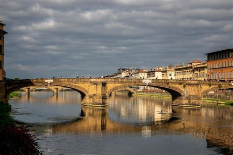 View Of Buildings Along And Across The River Arno In