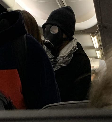 A man caused panic wearing a gas mask on American Airlines